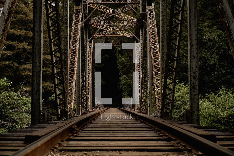 support beams over a railroad bridge