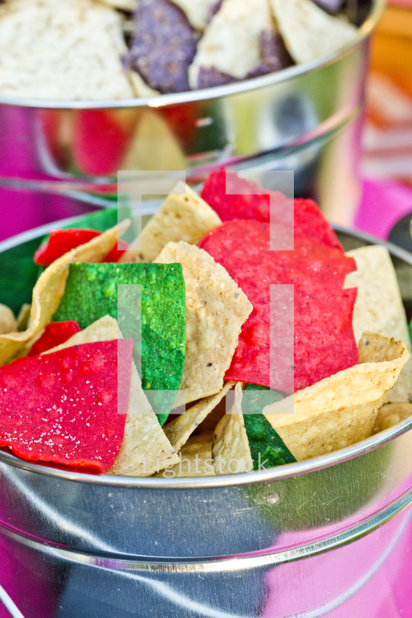 A bucket of colorful tortilla chips Mexican food bucket