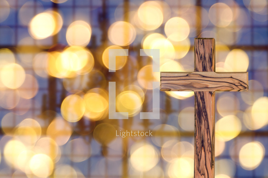 wooden cross and bokeh lights