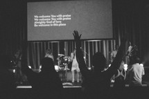 worshipers singing at a worship service