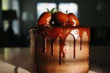 strawberries on a chocolate cake