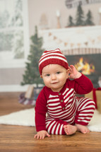 infant in Christmas pajamas