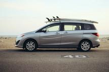 surfboards on top of a minivan