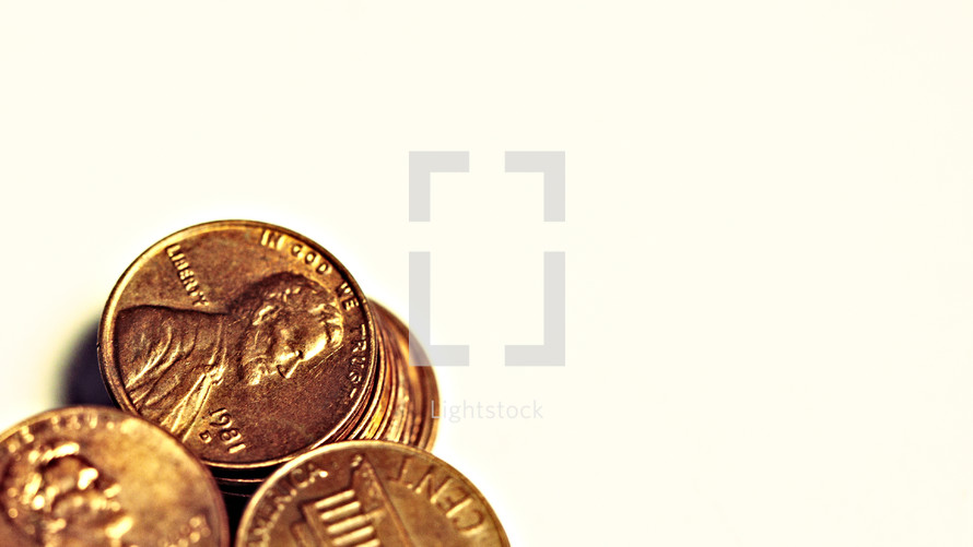 Three stacks of pennies isolated on white