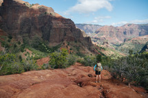 woman exploring a mountainous landscape