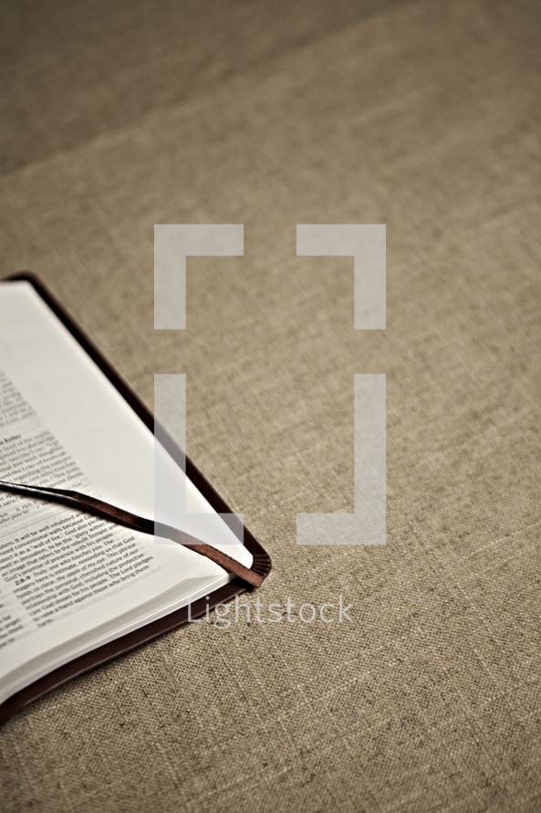 The corner of an open bible
