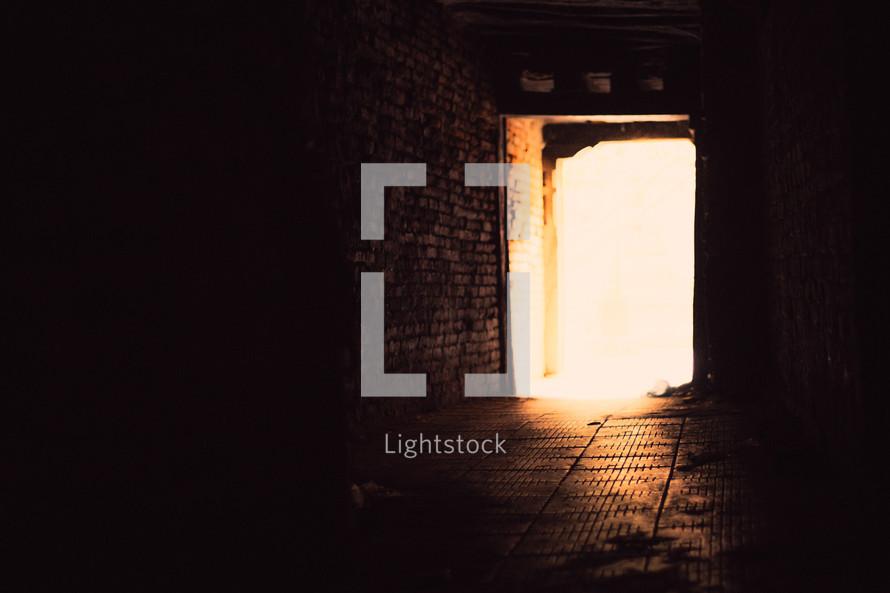 sunlight through a door opening in a basement in Nepal