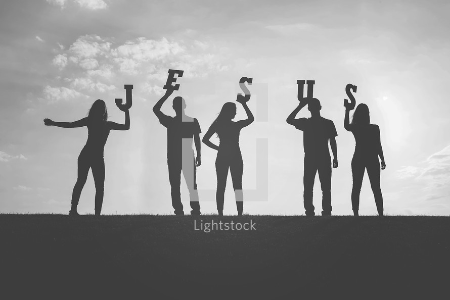 silhouettes holding the word Jesus