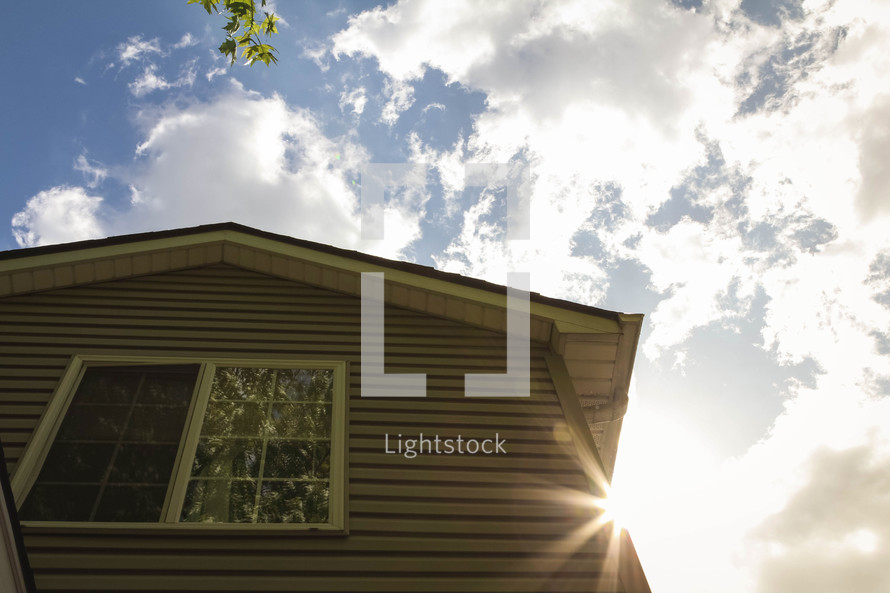 sunburst behind a house