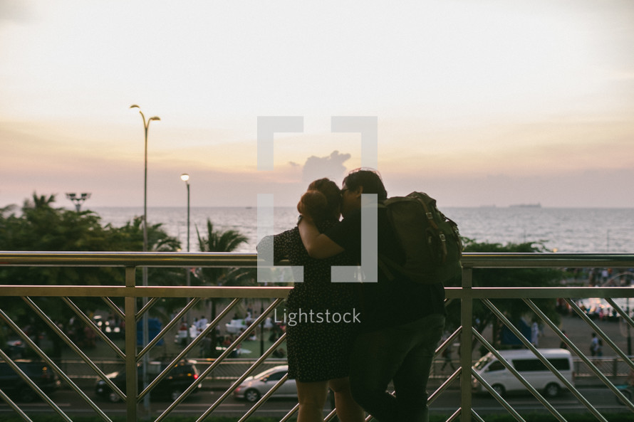 a couple stealing a kiss