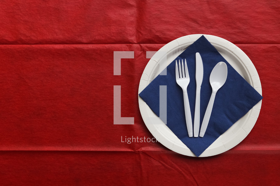 red, white, and blue paper plate place setting