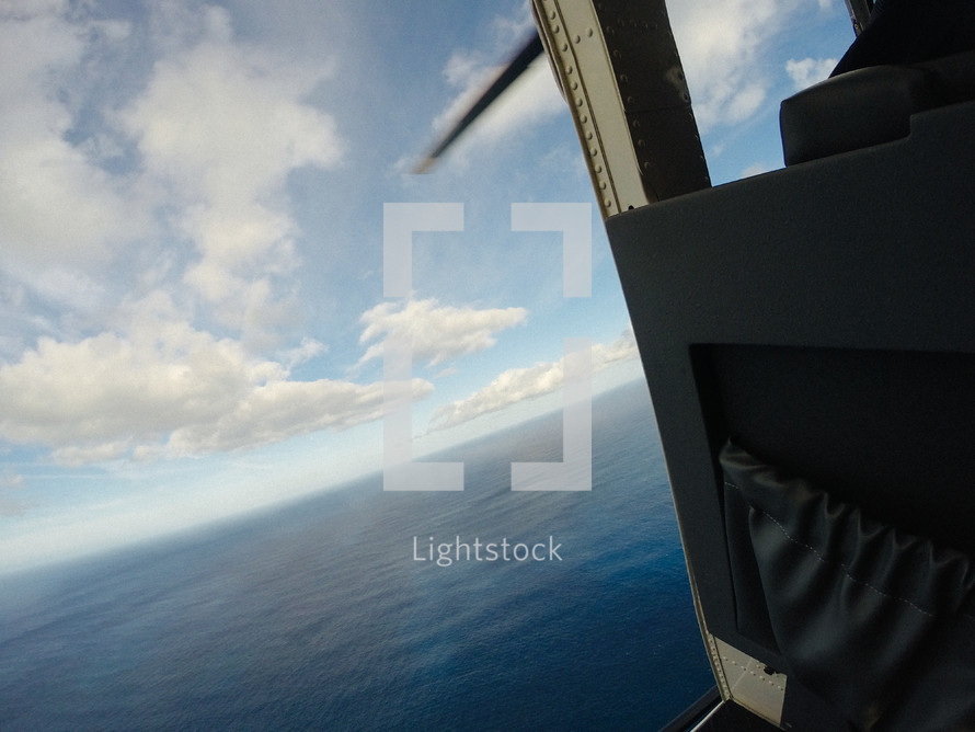 view from a helicopter of the ocean below