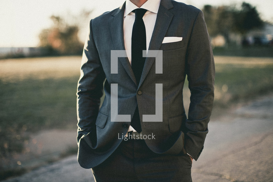 A man dressed in a suit and tie