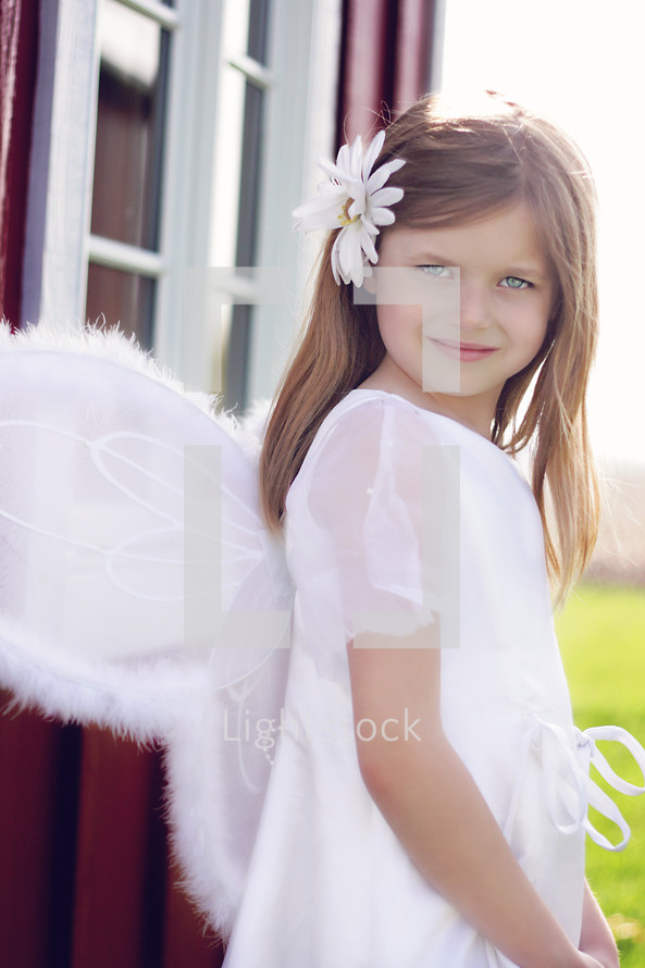 A little girl dressed as an angel