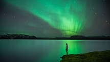 aurora over water in Iceland