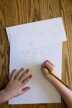 a child writing a thank you note to God