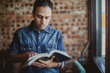 Latino man reading a Bible