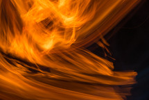 Swirling orange flames on a black background.