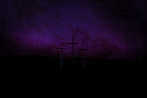 Good Friday crosses against a purple sky