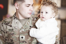 military father holding his son