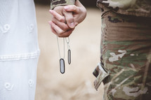 military couple holding hands