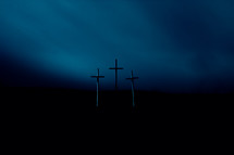 Good Friday crosses against a dark sky
