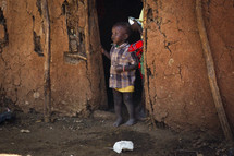 child in a doorway in Africa