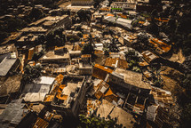 aerial view over a hurricane damaged island community