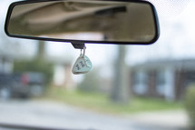 I pick you guitar pic hanging on a car mirror