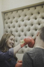 playful boxing couple