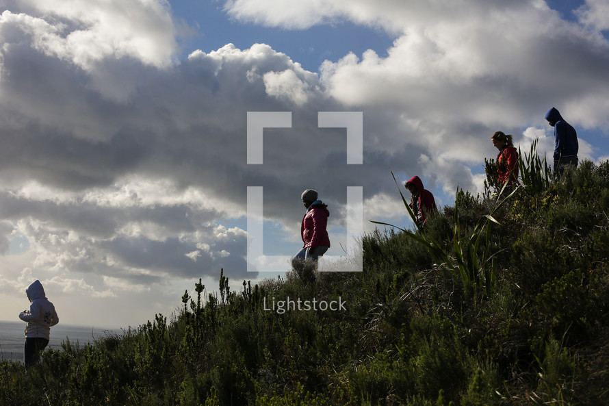 Group hiking down a hill