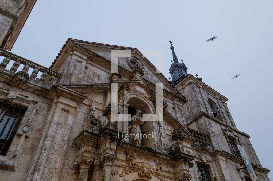 crosses on steeples on a stone cathedral
