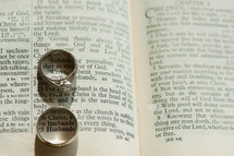 engagement ring and wedding band on a Bible