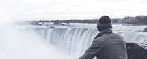 a man looking out over the Niagara Falls