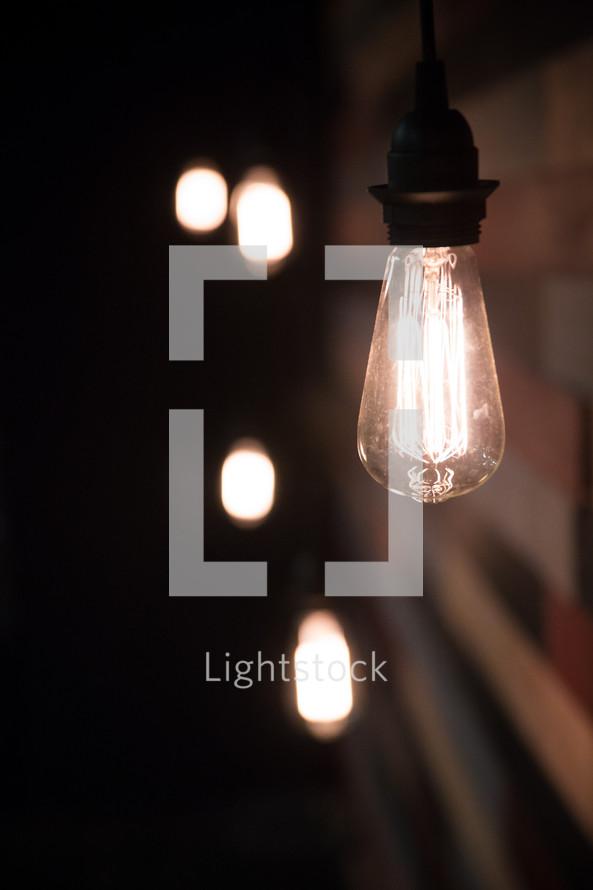 glowing hanging lightbulbs