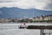 marina, jetty, and buildings along a shoreline in Switzerland