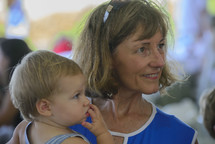 a grandmother holding her grandson
