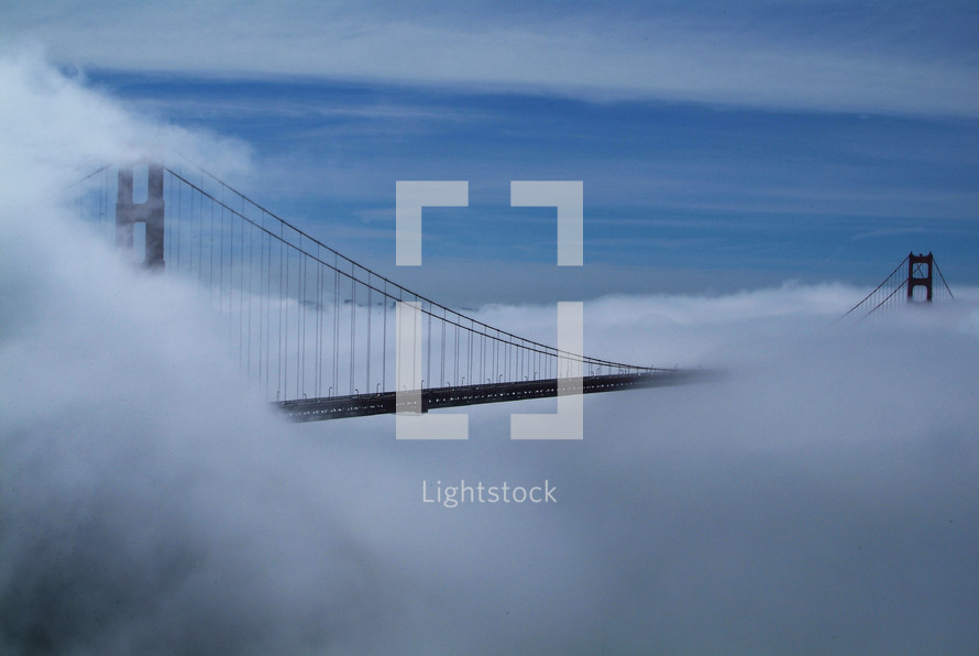 Fog over Golden Gate bridge. Clouds.