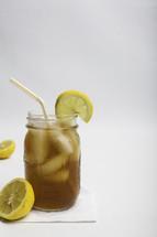 iced tea with lemon in a mason jar