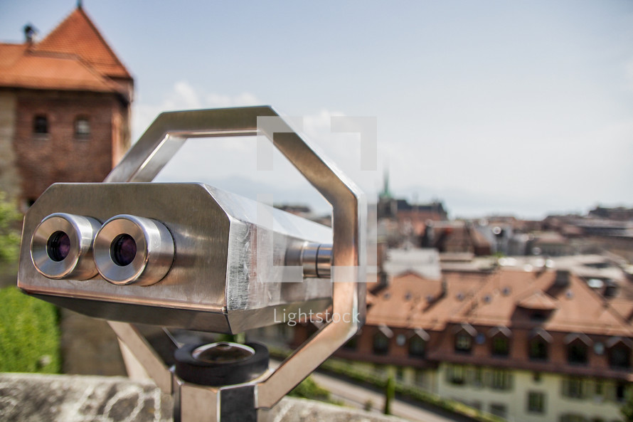 viewfinder telescope and view of city in Switzerland