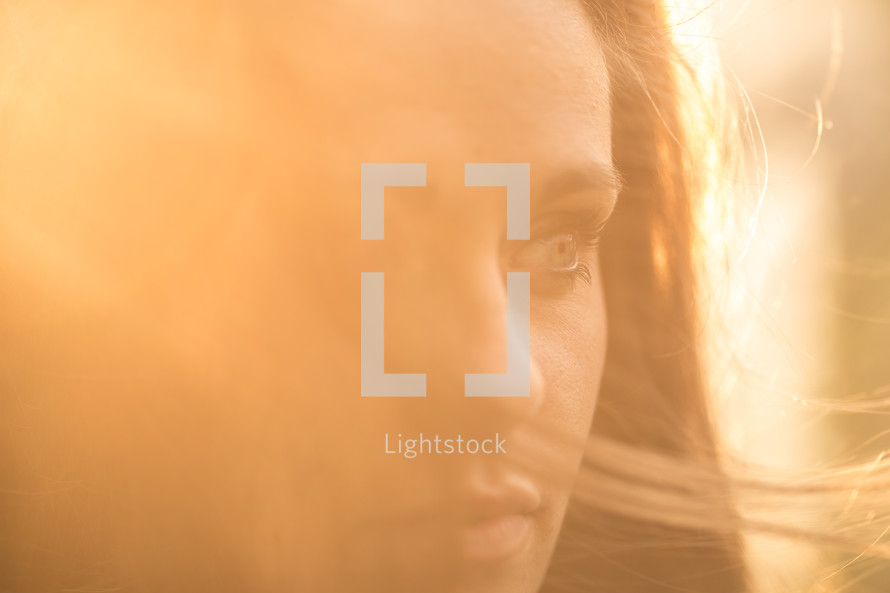 profile of a woman glowing in the sunlight