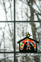 stained glass children's craft of the nativity scene in a window