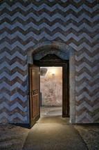 Castle door and chevron walls