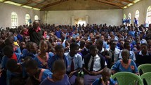 children getting ready for a church service to start