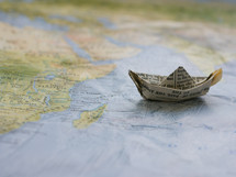 paper boat on a map