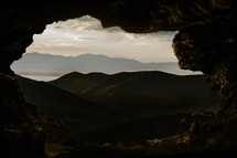 view of mountains from a cave