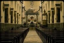 interior of a Guatemala cathedral - altar, pews, aisle