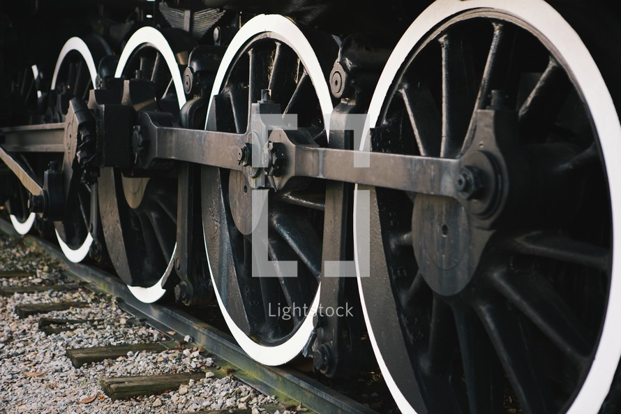 wheels of a train on the track.
