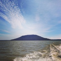 view of distant while on a boat on a lake