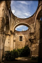arches and blue sky in a Guatemala cathedrals courtyard